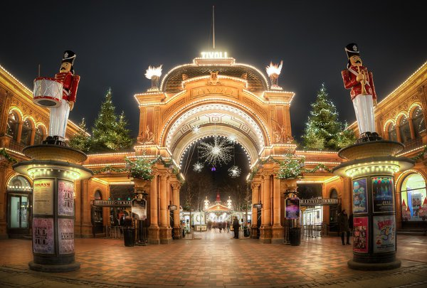 Copenhagen Tivoli Gardens is the second oldest amusements parks in the world. At Christmas they open with Christmas Stalls where you can buy all kinds goodies for your belly and go around and get a true Christmas feeling. Absolutelly very recommendable if you ever go to Copenhagen during Christmast. This is the main entrance. Photo by: Jacob Surland, www.caughtinpixels.com
